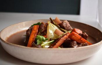 Pot roast with vegetables in bowl